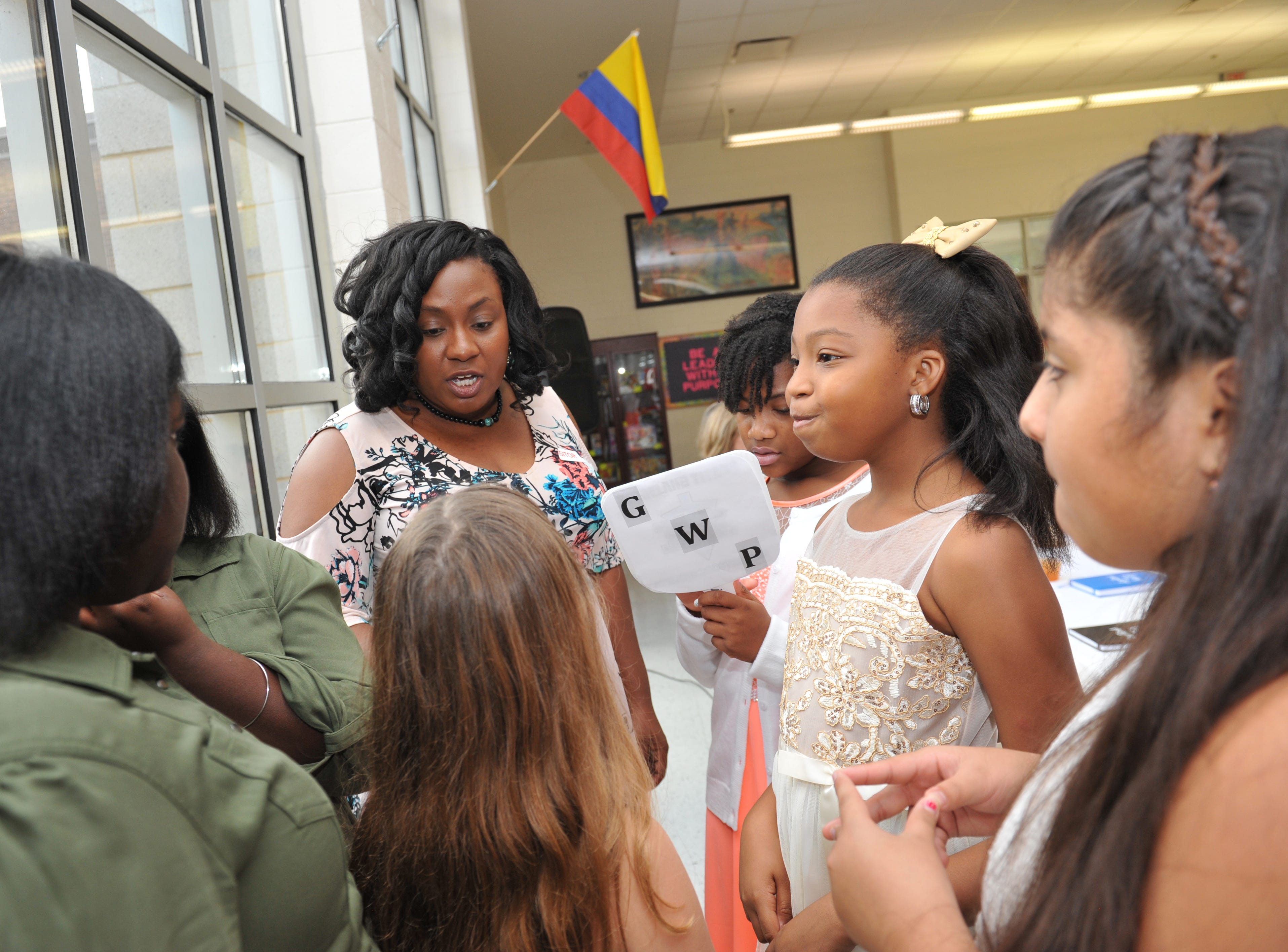 Madison County Justice Court Judge Martina Griffin chats with Highland Elementary School 5th grade girls about college before the Girls with Purpose Club Mother-Daughter tea begins on Friday, Sept. 21, 2019.