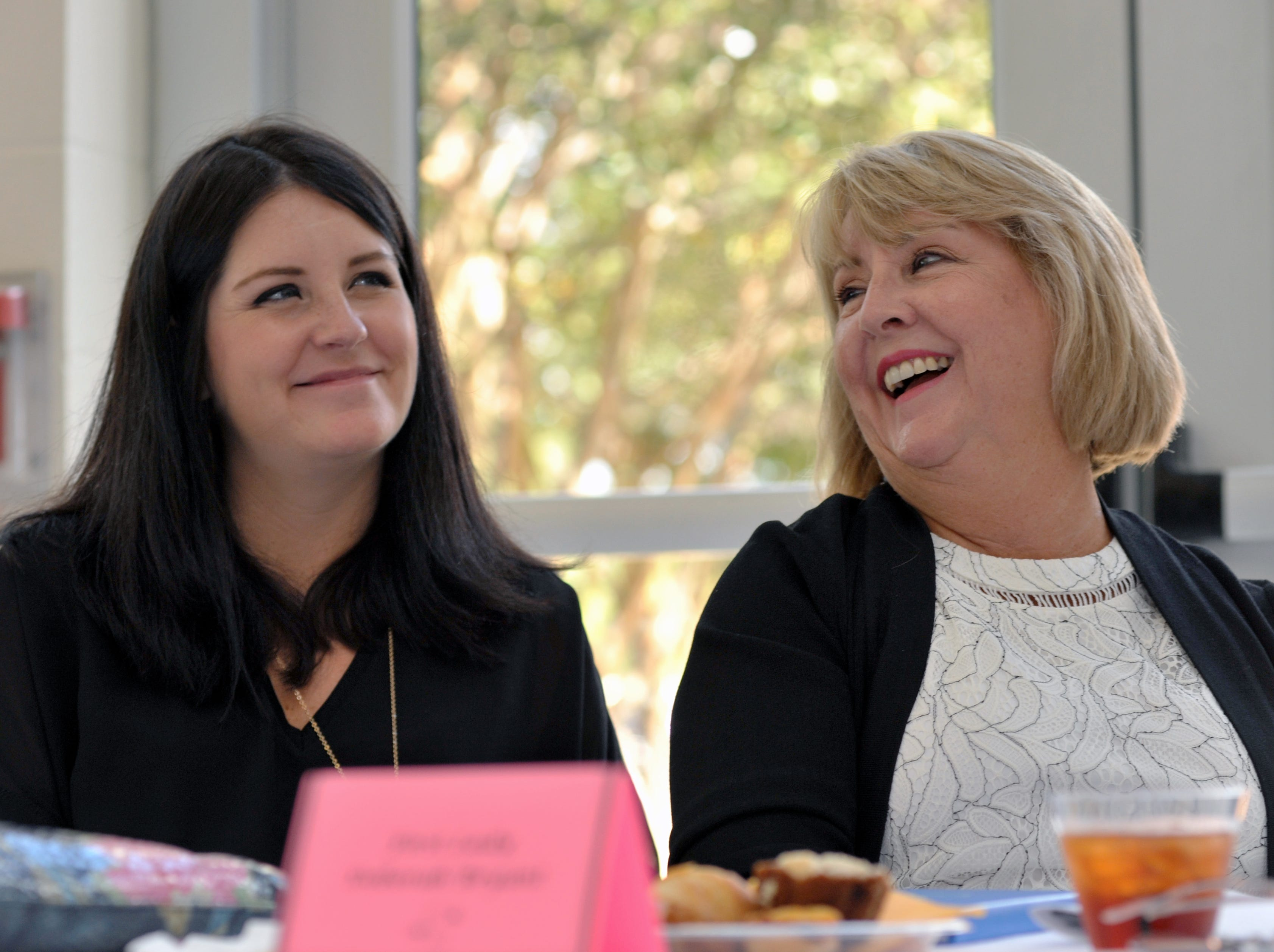 Mississippi First Lady Deborah Bryant, right, and her daughter Katie Bryant Snell, enjoy the girls' speeches during the Girls with Purpose Club Mother Daughter Tea at Highland Elementary School in Ridgeland Friday, Sept. 21, 2018.