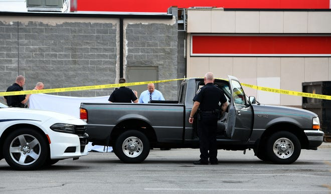 KCSO investigating a shooting in the parking lot behind the Exxon station on Kingston Pike at Cedar Bluff Rd which they believe to be a suicide Monday, September 24, 2018.