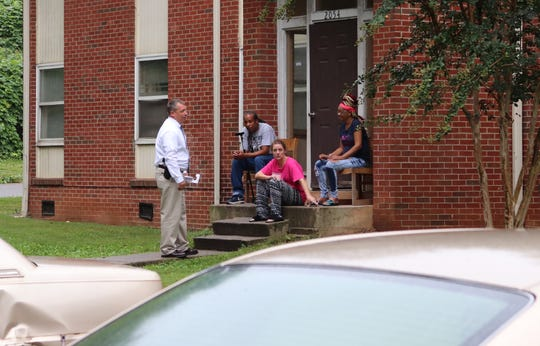 An investigator discusses Colin Jackson's homicide with residents of the Morningside Hills apartment complex two years after the crime, while re-canvassing the area.
