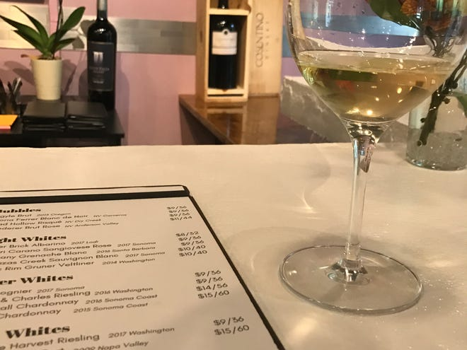 A menu and glass of wine at the Double S Wine Bar.