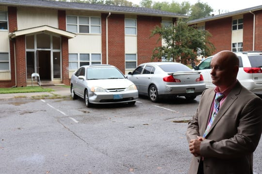 Investigator Clayton Madison stands outside 2054 Dandridge Ave., where Colin Jackson was found shot to death.