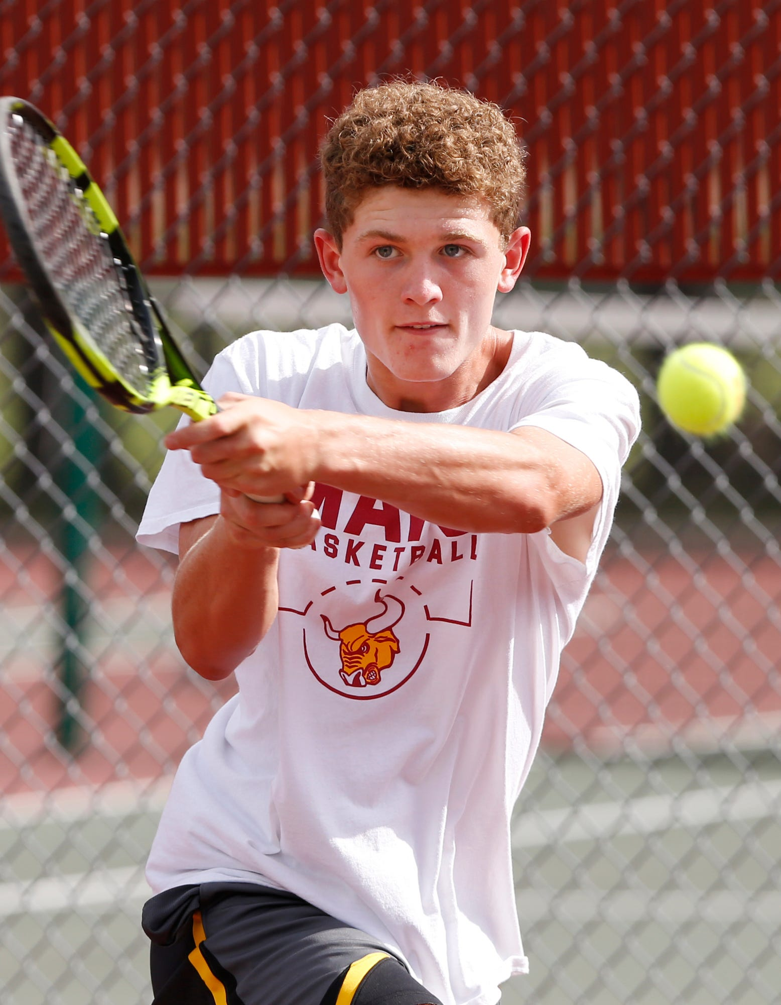 Rowen Farrell with a return during tennis practice Monday at McCutcheon. Farrell plays at No. 3 singles for the Mavericks, who are pursuing the school's first sectional title..