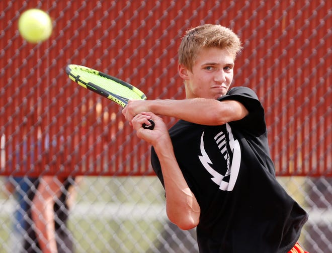 Gavin Dardeen with a return during tennis practice Monday at McCutcheon High School. Dardeen plays at No. 1 singles for the Mavericks.