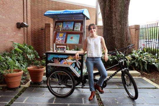 Local artist Cayla Mattea Zeek is seen with Lafayette's new Bibliobike.