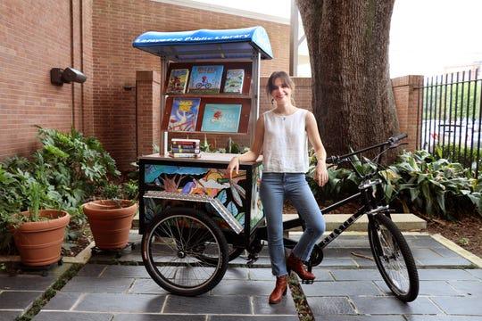 Local artist Cayla Mattea Zeek is seen with Lafayette's new Bibliobike.