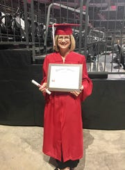 Julie Chambers, 51, holds her diploma for a bachelor's in counseling from the University of Louisiana at Lafayette. Now she is pursuing a master's.