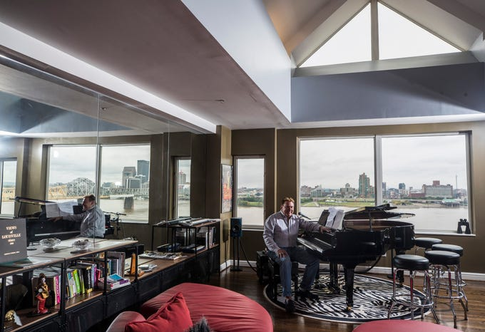 Gary Matheis at his grand piano in his sprawling condiuminum home on the top floor of the Harbours in Jeffersonville. He never thought he'd live in Indiana until he saw the view. He sold his Highlands home in two months and loves living on the 'Sunny Side.' He also likes being close to the Interstate as he takes trips to Chicago often as part of his business. Sept. 17, 2018.