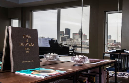 A book titled 'Views of Louisville' is at home with the Louisville skyline reflected in a floor-to-ceiling mirror in the living room. Sept. 17, 2018.