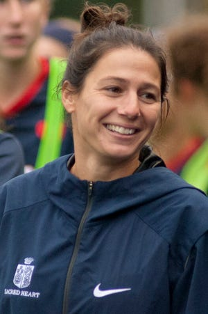Sacred Heart head soccer coach Libbey Smith smiles during the game against Assumption. Smith is in her first year of the job and the Valkyries are tied for 1st place in the state.September 23, 2018