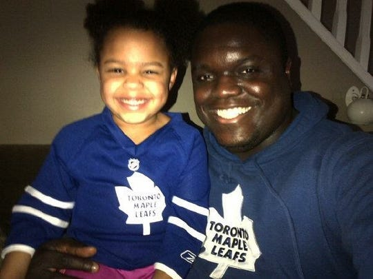 Mike Labinjo, pictured here with his 10-year-old daughter, Hailey, died Saturday morning in his sleep. He was 38.