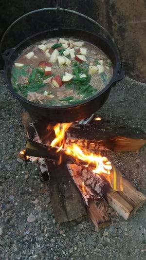Fresh potatoes, green beans, onions and chunks of steak went into a stew cooked over an open fire on a recent Friday night for the Eichers.