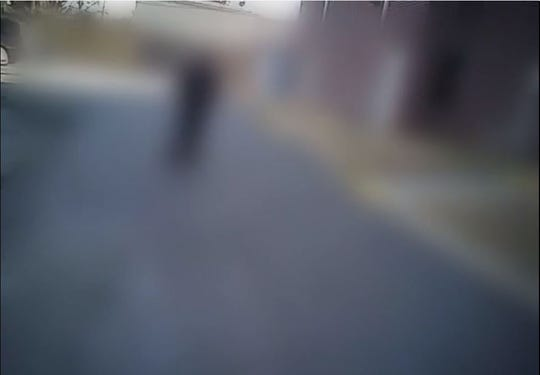 This heavily redacted image comes from the body camera of an officer called to the scene of the Jan. 27, 2016 shooting of Jonathon Bratcher. This image was apparently taken after the shooting, and the human figure in the picture is apparently another police officer.