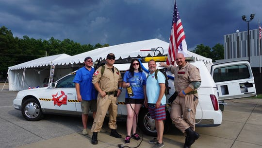 """Darrell Argo, left, Victoria """"Thunderbunny """" Jones and Glenn Freeman pose for a photo during a Snowden Grove event with Ghostbusters Jack Johnson and Cory Coffman."""
