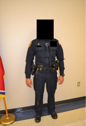 An anonymous officer involved in the January 2016 fatal shooting of Jonathan Bratcher stands in this Tennessee Bureau of Investigation evidence photo. The Shelby County District Attorney's office redacted his face and other identifying details.