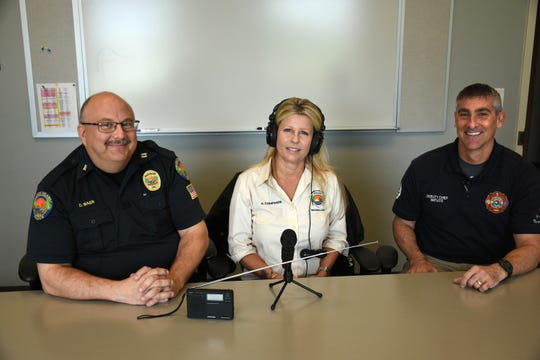 MIPD Capt. Dave Baer, left, Heather Comparini and MIFD Deputy Chief David Batiato are some of the voices on the new broadcasts. The Marco Island Police Dept. is on the air with their low-power AM radio broadcasts, aimed at getting safety information out to island residents.