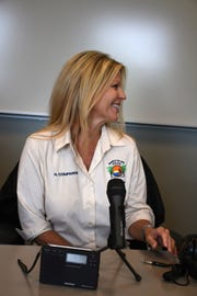 MIPD records clerk Heather Comparini is recording messages for the emergency radio network. The Marco Island Police Dept. is on the air with their low-power AM radio broadcasts, aimed at getting safety information out to island residents.