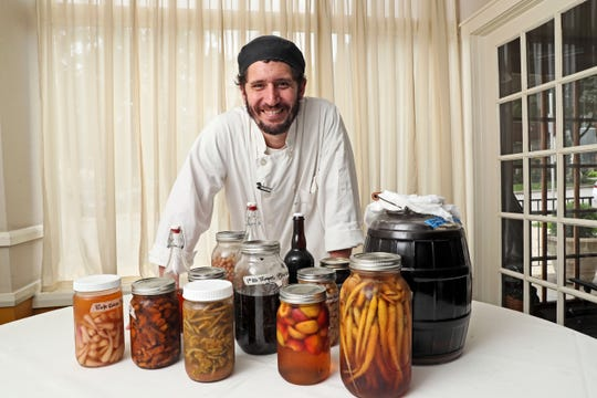 Justin Aprahamian shows off just a few of the foods he preserves to incorporate into dishes he serves at Sanford Restaurant.