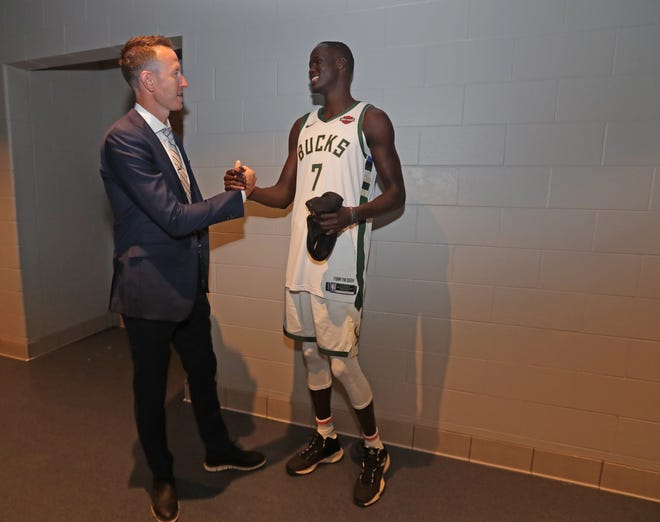 Steve Novak (left), television analyst for the Milwaukee Bucks on Fox Sports, talks with Thon Maker.