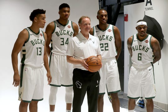 New Bucks head coach Mike Budenholzer poses for a photo during media day with (from left) Malcolm Brogdon, Giannis Antetokounmpo, Khris Middleton and Eric Bledsoe.