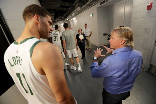 Brook Lopez talks to Milwaukee Bucks co-owner Wes Edens during media day.