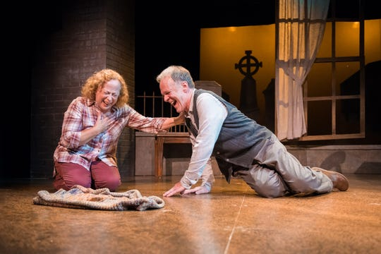 """Jenny Wanasek and James Tasse share an unexpected laugh during """"Chapatti,"""" performed by Milwaukee Chamber Theatre."""
