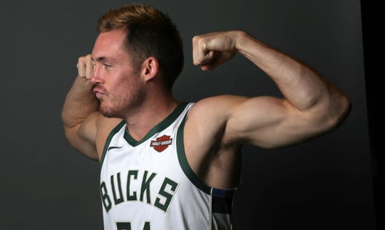Pat Connaughton hams it up for a photo at the Bucks' media day.