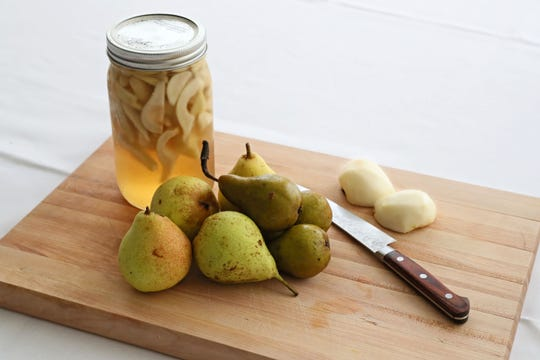 Pickled pears are a specialty item Justin Aprahamian makes at Sanford Restaurant.