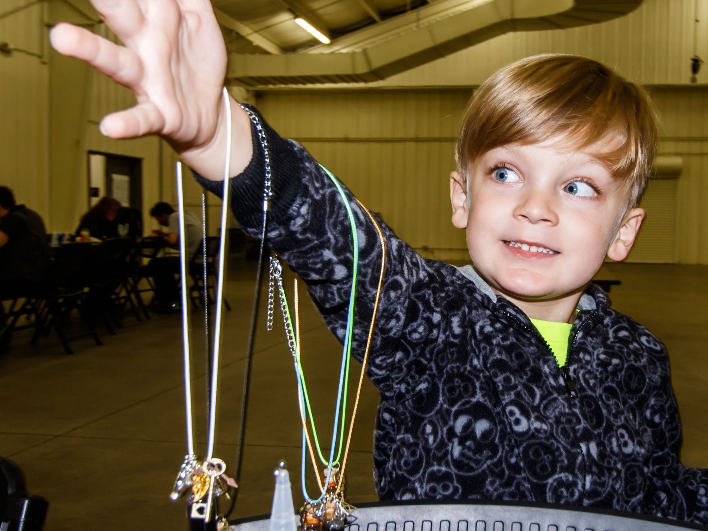 Brody O'Neil, 6, of Waukesha shows off the magical potion and charm necklaces he created during the Midwest Magic Fest at the Waukesha Expo Center on Sunday, Sept. 23, 2018. The family friendly event featured one-of-a-kind entertainment, mythical creatures, games, crafts, vendors, unique photo-ops, costume contests and much more.