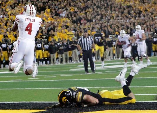 Ncaa Football Wisconsin At Iowa