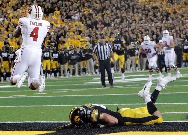 Wisconsin wide receiver A.J. Taylor makes the winning touchdown catch while being covered bay Iowa linebacker Nick Niemann on Saturday night in Iowa City.