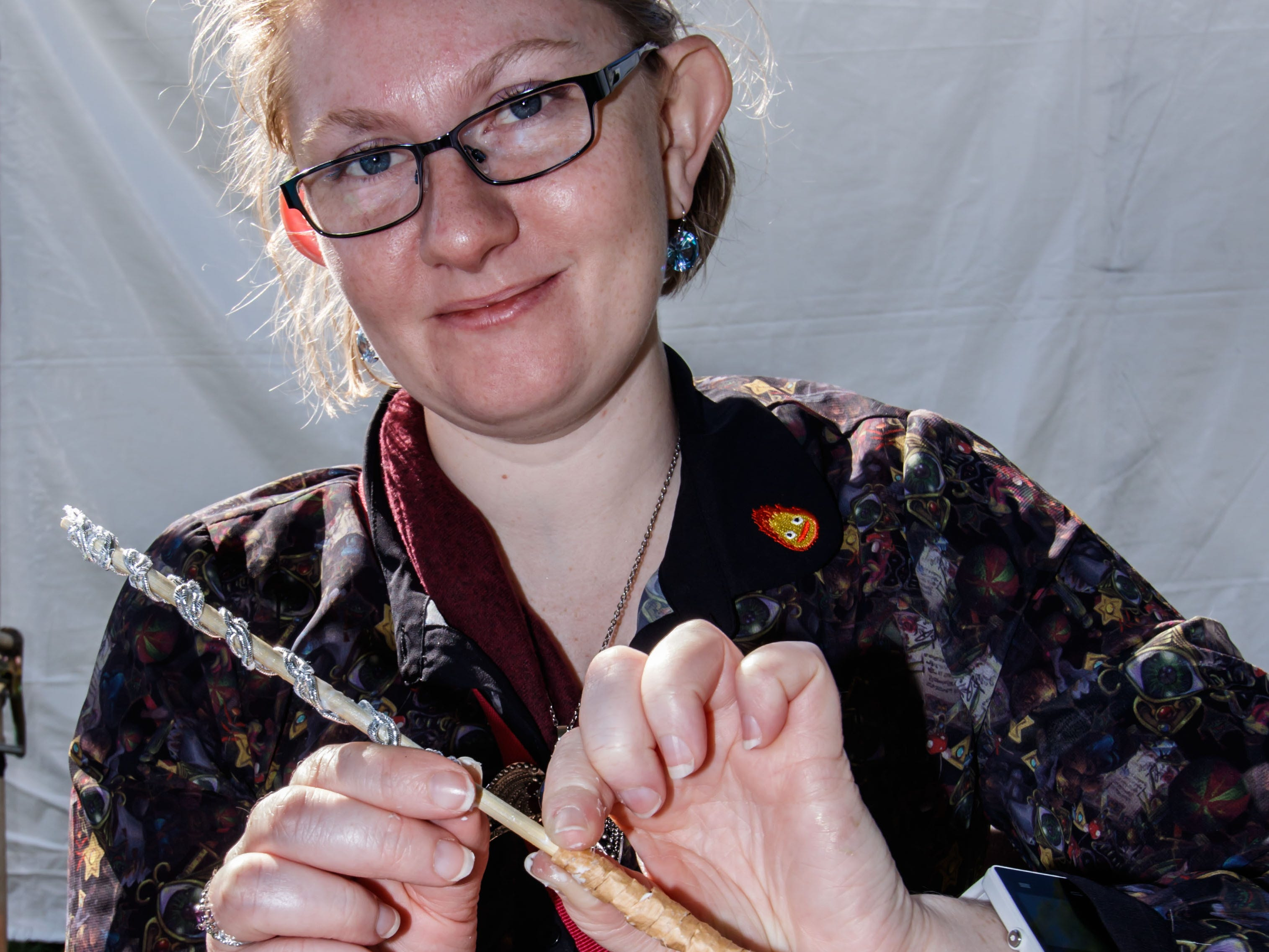 Mara Wilcox of Milwaukee builds her own magic wand during the Midwest Magic Fest at the Waukesha Expo Center on Sunday, Sept. 23, 2018. The family friendly event featured one-of-a-kind entertainment, mythical creatures, games, crafts, vendors, unique photo-ops, costume contests and much more.