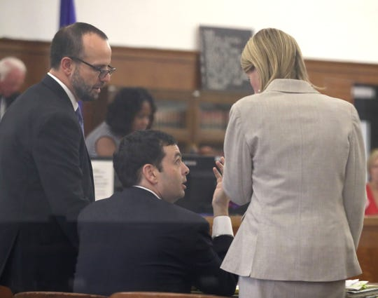 Kris Zocco speaks with his attorneys, Craig Mastantuono (left) and Rebecca Coffee, during jury selection. He is charged in the death of Kelly Dwyer.