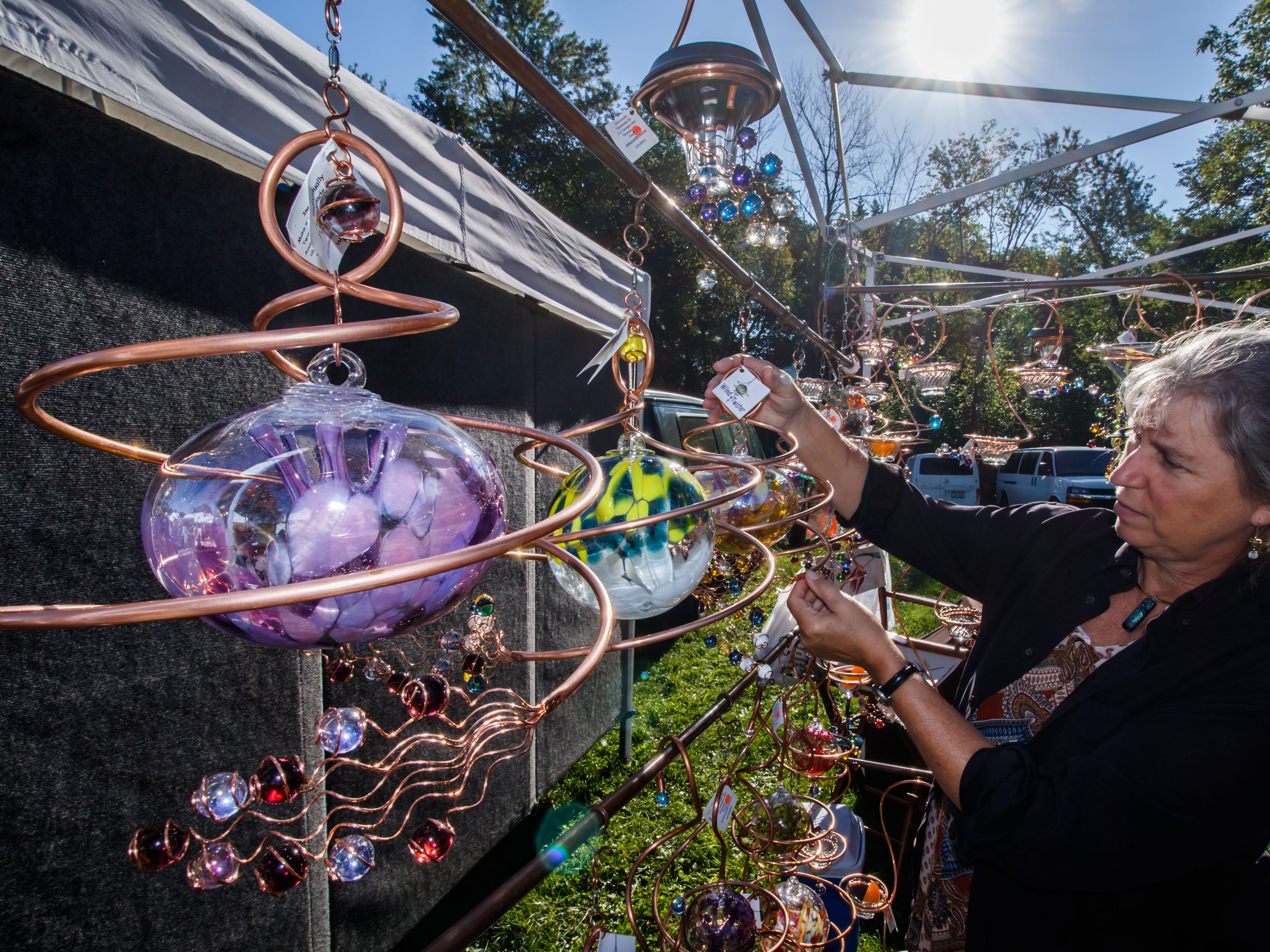 Janet Erickson of JLE Designs in Theresa adjusts one of her handcrafted artworks during the 50th annual Cheery Cherry Fall Fair in Menomonee Falls on Sunday, Sept. 23, 2018. The event features arts and crafts vendors, raffles, wine tasting, a beer garden, live music and more.