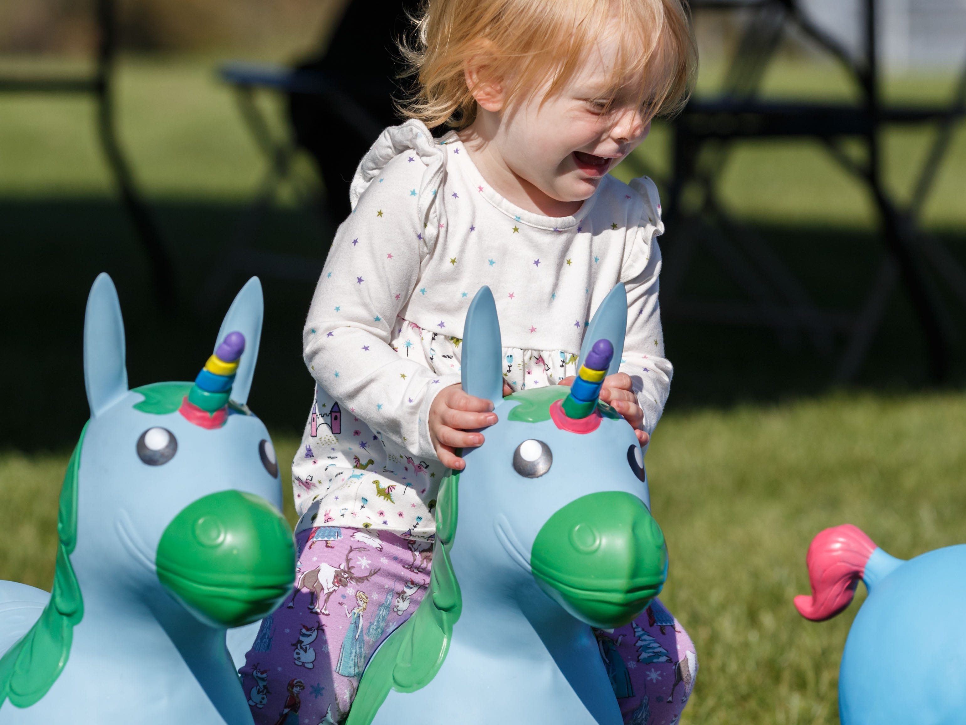 Two-year-old Evelyn Bennett of Waukesha takes a ride on a bouncy unicorn during the Midwest Magic Fest at the Waukesha Expo Center on Sunday, Sept. 23, 2018. The family friendly event featured one-of-a-kind entertainment, mythical creatures, games, crafts, vendors, unique photo-ops, costume contests and much more.