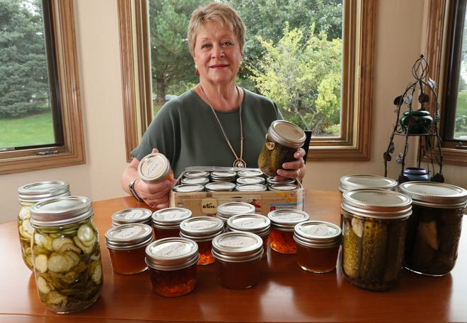 Mary Horton Carstensen of Franklin displays some of her canned items, including kosher dill pickles, peach and blueberry jam, pepper jelly and pickled jalapeno peppers from her garden, and her refrigerator sweet pickles.