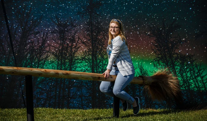 Jessicca Adrihan of Milwaukee stops for a photo with a giant broomstick during the Midwest Magic Fest at the Waukesha County Expo Center on Sunday, Sept. 23, 2018. The family friendly event featured one-of-a-kind entertainment, mythical creatures, games, crafts, vendors, unique photo-ops, costume contests and much more.