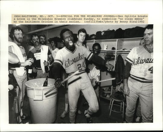 "Ben Ogilvie breaks a broom in Milwaukee Brewers clubhouse Sunday, to symbolize ""no clean sweep"" by the Baltimore Orioles in their series to close the 1982 season."