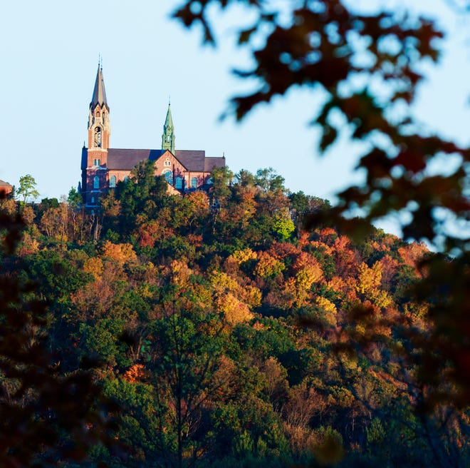 Fall foliage offers brilliant colors beneath the Basilica of the National Shrine of Mary, Help of Christians, at Holy Hill in Hubertus.