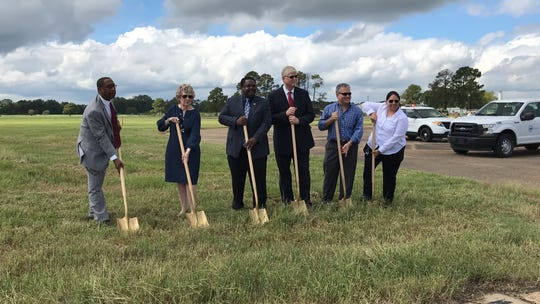 City officials at a groundbreaking for a runway expansion at Monroe Regional Airport.