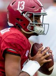 Alabama quarterback Tua Tagovailoa (13) warms up before the Alabama vs. Texas A&M game in Tuscaloosa, Ala., on Saturday September 22, 2018.
