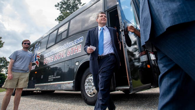 Democratic gubernatorial nominee Walt Maddox arrives for a press conference front of the Montgomery Area Mental Health Authority office in Montgomery, Ala., as he campaigns across the state on his bus tour on Monday September 24, 2018.