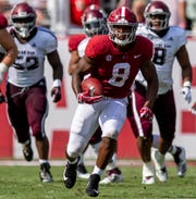 Alabama running back Josh Jacobs (8) carries against Texas A&M in first half action in Tuscaloosa, Ala., on Saturday September 22, 2018.