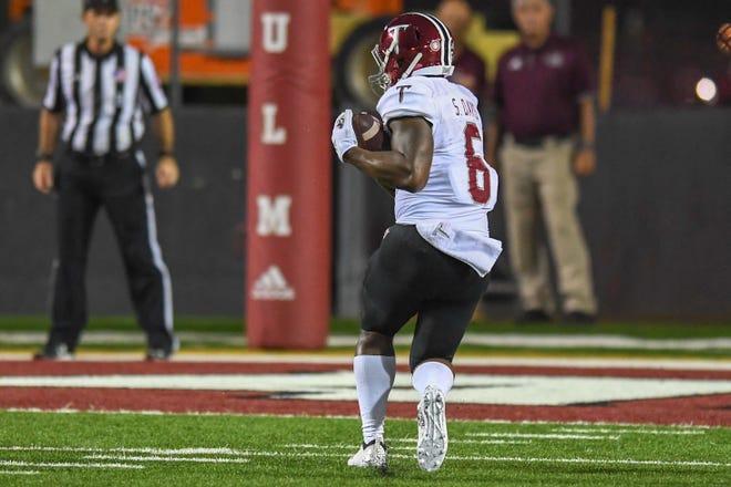 Troy receiver Sidney Davis, whose second-quarter touchdown at Louisiana-Monroe gave the Trojans a 35-7 lead, says fatherhood motivates him.