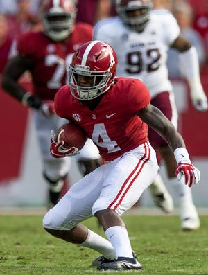 Alabama wide receiver Jerry Jeudy (4) catches a pass against Texas A&M in first half action in Tuscaloosa, Ala., on Saturday September 22, 2018.