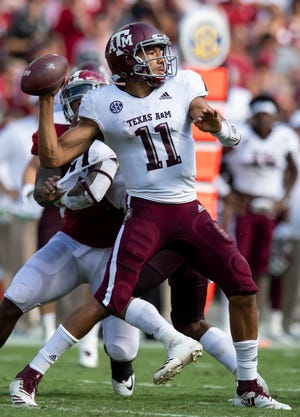 Texas A&M quarterback Kellen Mond (11) passes against Alabama in first half action in Tuscaloosa, Ala., on Saturday September 22, 2018.