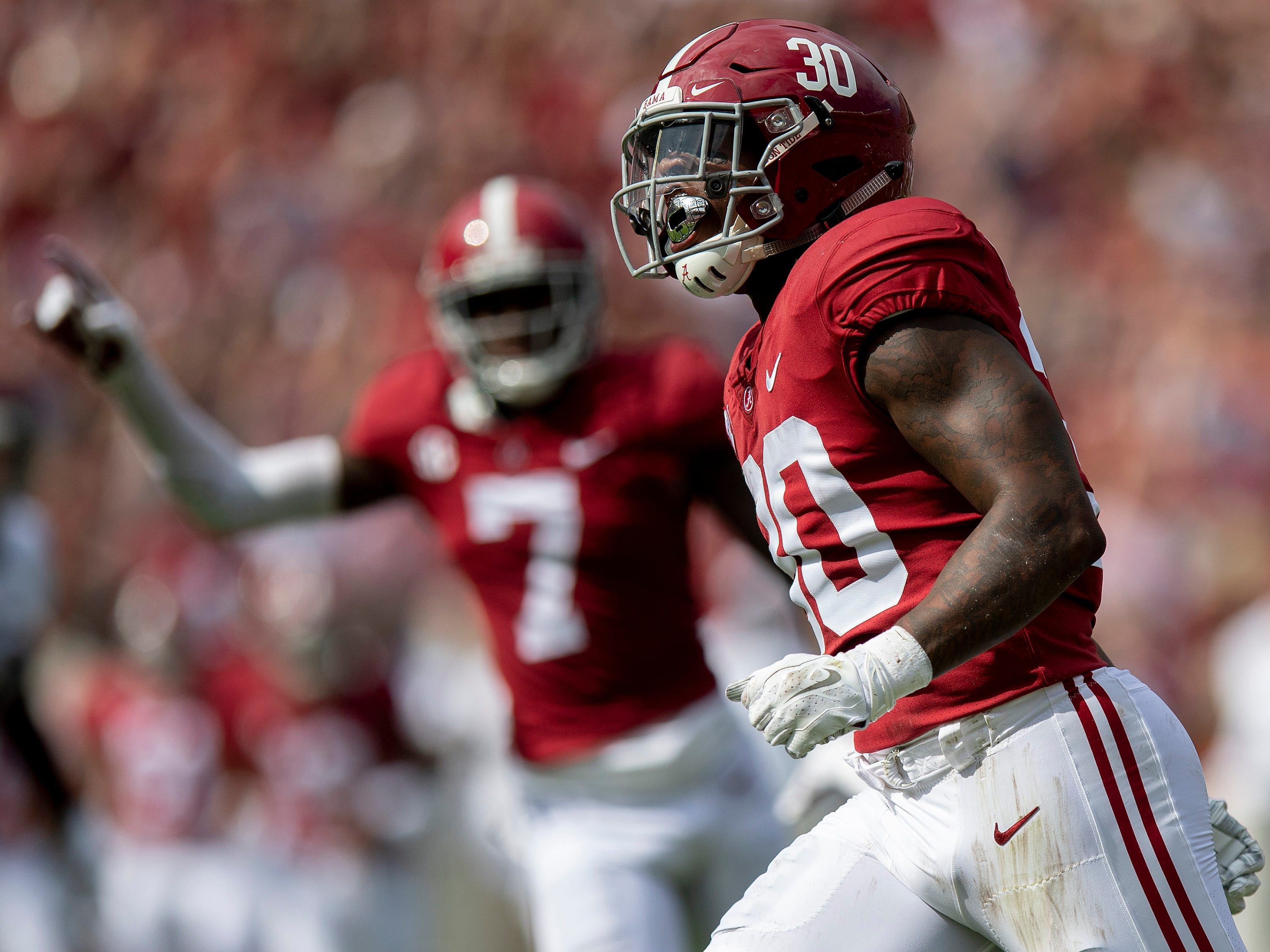Alabama linebacker Mack Wilson (30) celebrates intercepting a pass against Texas A&M in first half action in Tuscaloosa, Ala., on Saturday September 22, 2018.