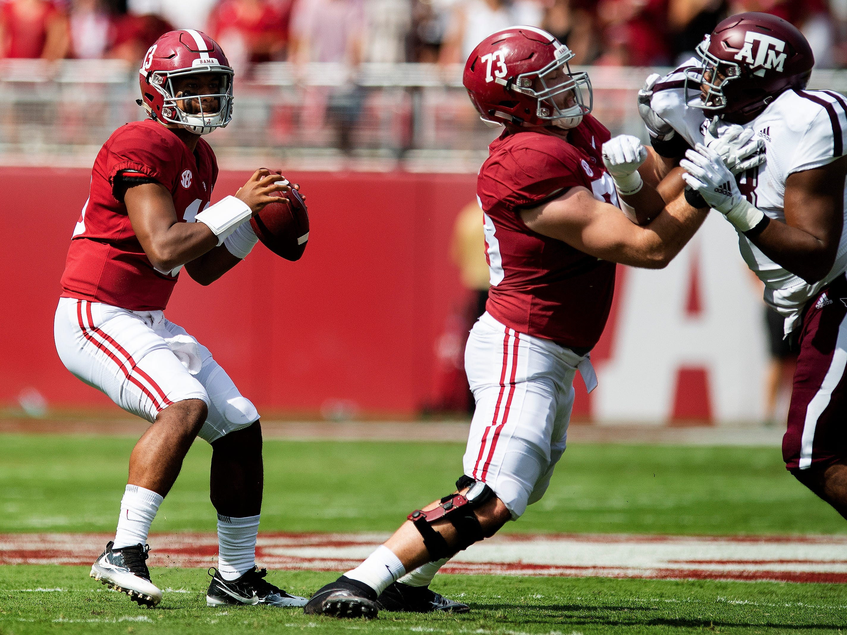 Alabama quarterback Tua Tagovailoa (13) passes behind the blocking of offensive lineman Jonah Williams (73) in first half action in Tuscaloosa, Ala., on Saturday September 22, 2018.