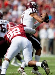 Alabama defensive lineman Quinnen Williams (92) wraps up Texas A&M quarterback Kellen Mond (11) in first half action in Tuscaloosa, Ala., on Saturday September 22, 2018.
