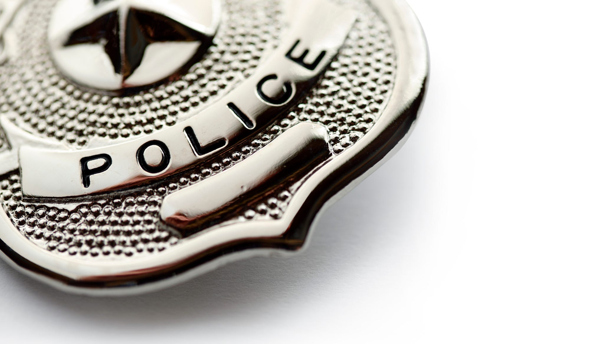 Police badge on white background.